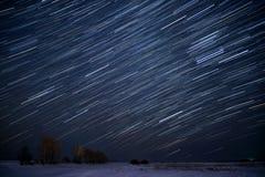 Star tracks sky snow field Stock Photography