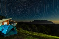 Star trail above Doi Luang mountain seen from Doi Ma Taman camping site. Chiang Mai, Thailand stock photography