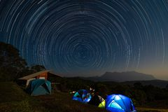 Star trail above Doi Luang mountain seen from Doi Ma Taman camping site. Chiang Mai, Thailand royalty free stock images