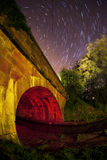 Star trail of a canal bridge Royalty Free Stock Image