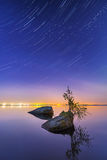 Star trail effect over the lake Stock Photos