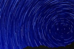 Star trail effect over mountain night sky Royalty Free Stock Photos