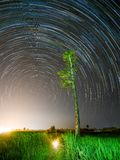 Star trail at the field. Sky and stars stock images
