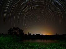 Star trail at the field. Sky and stars stock image