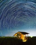 Star trail at the field. Sky and stars royalty free stock images