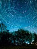 Star trail at the fields. Star trail fields night sky nature dark astronomy landscape motion long starry science galaxy circle background nroth celestial royalty free stock photography