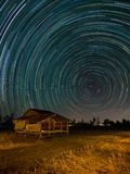 Star trail at the fields. Star trail fields night sky nature dark astronomy landscape motion long starry science galaxy circle background nroth celestial stock images