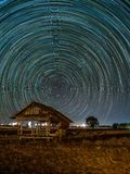 Star trail at the fields. Star trail fields night sky nature dark astronomy landscape motion long starry science galaxy circle background nroth celestial royalty free stock image