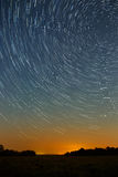 Star trail in the night sky with bright meteors and aircraft ligh Royalty Free Stock Image