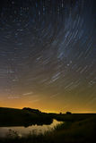 Star trail in the night sky Stock Photos