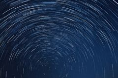 Star Trail Night sky. Compilation of 90 photos stacked in one called Star Trail Night Sky stock photo