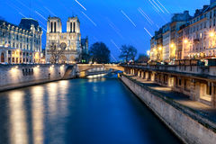 Star Trail at Notre Dame. Paris Stock Photo