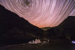 Star Trail over Mountains Reflecting in Altitude Lake royalty free stock photo