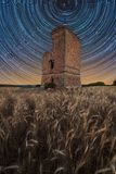 Star trail over an old castle stock images