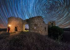 Star trail over an old castle stock photos