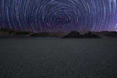 Star trail over Race Track. In Death Valley National Park, USA stock photo