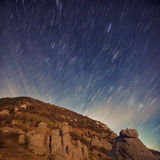 Star Trail over the rocks Stock Photo