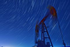 Star trail of Pumping unit. In Karamay oil field in China stock images