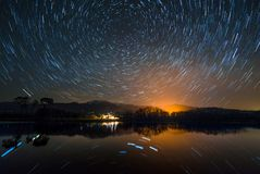 Star Trail reflexes. Star Trail in the mountains of gredos reflexes over reservoir of Rosarito,Spain stock photos