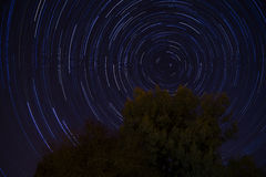 Star trails. Photograph taken over 108 minutes and involving over 200 photographs all combined into one. Polaris is the central point in the stars here as it Royalty Free Stock Photos