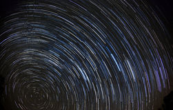 Star trails (90 minutes). 90 Minutes of star trails moving around the North Star (Polaris) as the Earth rotates Stock Photo
