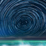 Star-trails above the Caribbean sea Stock Photo