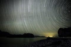 Star trails above an empty beach in Baja California Sur, Mexico Stock Photo