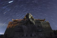 Star trails above Guan Yin statue at 500 Lohan Temple, Bintan Is. Land, Indonesia Royalty Free Stock Photo
