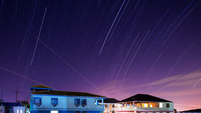 Star trails Across Plane Light Trails and Moon stock footage