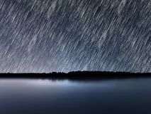 Star Trails, Beautiful Blue Night reflection Royalty Free Stock Images