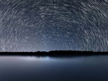 Star Trails, Beautiful Blue Night reflection Royalty Free Stock Photos