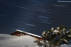 Star trails, buried building Stock Images