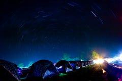 Star trails circle over camping tents at Phukradueng National. Park, Thailand royalty free stock photography