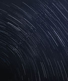 Star trails at the dark blue sky Royalty Free Stock Images