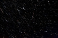 Star trails and falling perseid. In the sky Stock Image