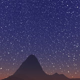 Star trails and far rocks Royalty Free Stock Photos