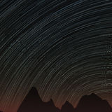 Star trails and far rocks Royalty Free Stock Images