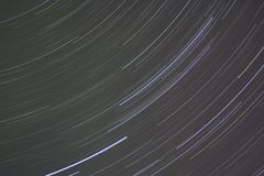 Star Trails in Green and Pink Night Sky Royalty Free Stock Photo