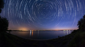 Star trails at the lake side panorama Stock Image