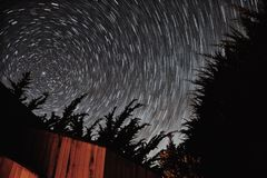 Star Trails. Long exposure of starry night sky framed by trees stock images