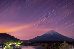 Star trails and Mount Fuji at twilight, the World Heritage. View at Lake Shoji ( Shojiko ). Fuji Five Lake region, Minamitsuru District, Yamanashi prefecture royalty free stock image