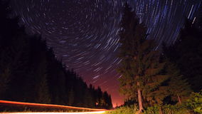 Star trails in the mountains forest road - moving stars timelapse stock video