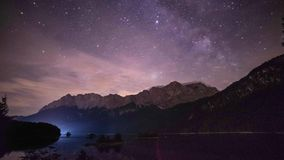 4K night time lapse of lake Eibsee and mountain Zugspitze in the German alps Bavaria