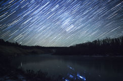 Star trails at night and  river Stock Photos