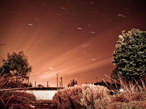 Star trails in night sky. Star trails in the night sky Stock Photo