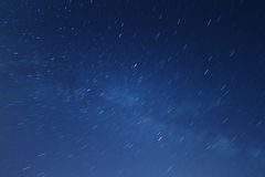 Star trails in the night sky. Star trails in blue night sky Stock Image