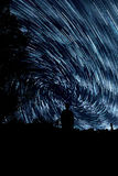 Star trails in night sky Stock Photo