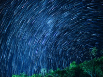 Star trails in the night sky.  Royalty Free Stock Image