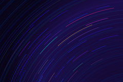 Star trails in night sky. Long exposure sky effect. Royalty Free Stock Image