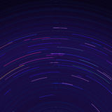 Star trails in night sky. Long exposure sky effect. Stock Photography